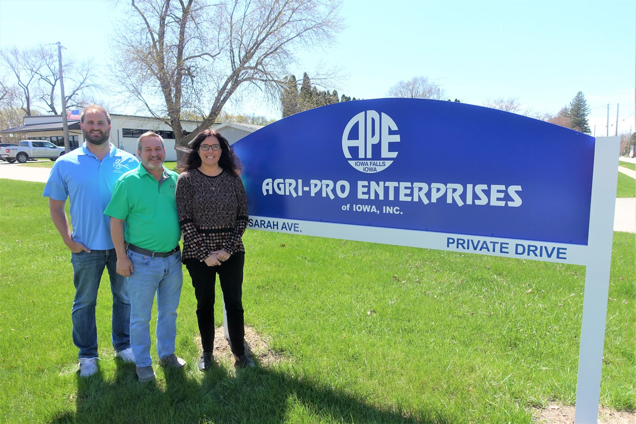 Matt, Joe, and Lari in front of Agri-Pro Enterprises