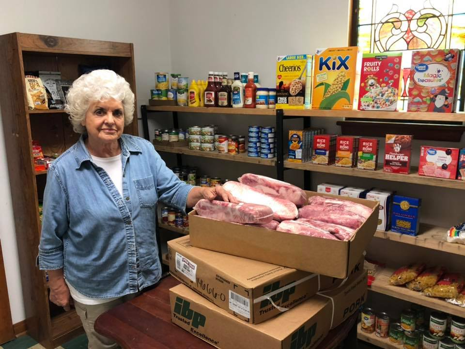 Bev standing by donation of pork loins