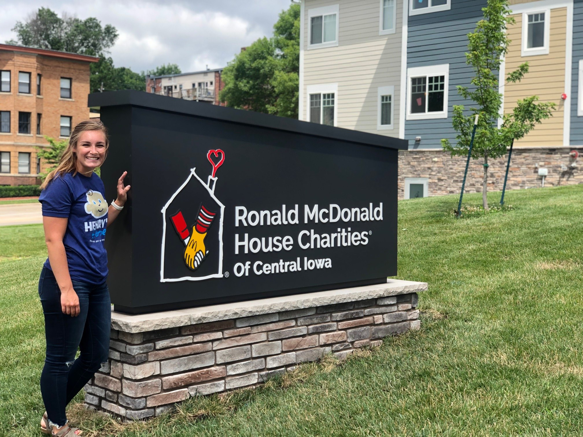 Lexie standing by Ronald McDonald sign